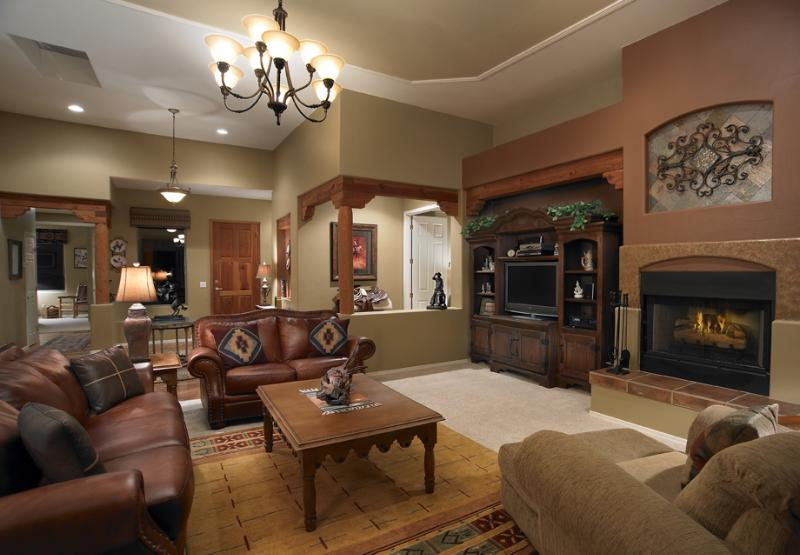 In This Living Room Leather Upholstery And Rustic Wood Furniture Provide The Foundations For Western Look But Details Nail Heads On